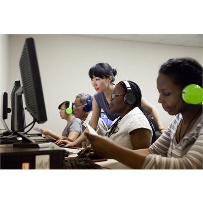 volunteers training on computers